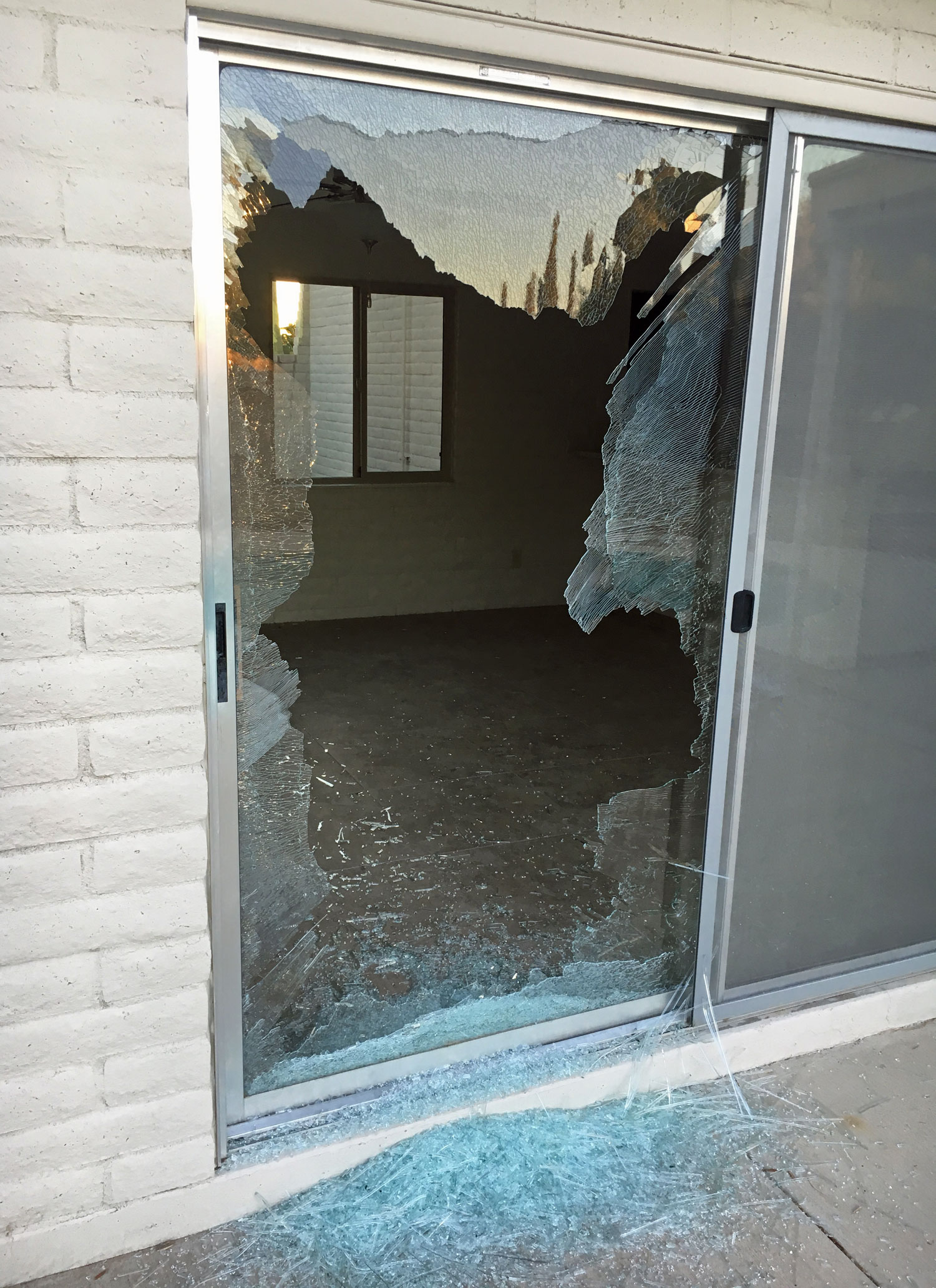 Sliding door glass broke